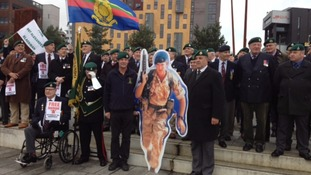 More than a thousand people rally to support 'Marine A'