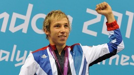 Jonathan Fox celebrates after winning gold in the Men&#x27;s 100m Backstroke.