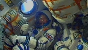 Tim Peake offers thumbs up from inside the Soyuz space capsule on his way to the ISS.