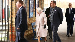 The Queen is followed by the Duke of Edinburgh as they leave King's Lynn station by a side gate.