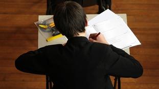 Pupil sitting GCSE exam
