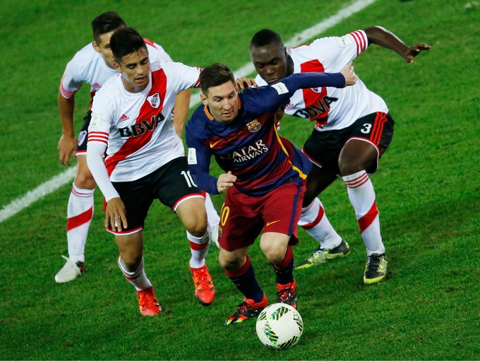 lionel messi evades three river plate defenders in yokohama