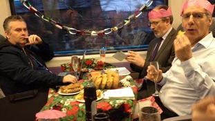 Friends hold Christmas party on the train to work