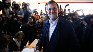 Spain's ruling conservatives win general election but lose parliamentary majority