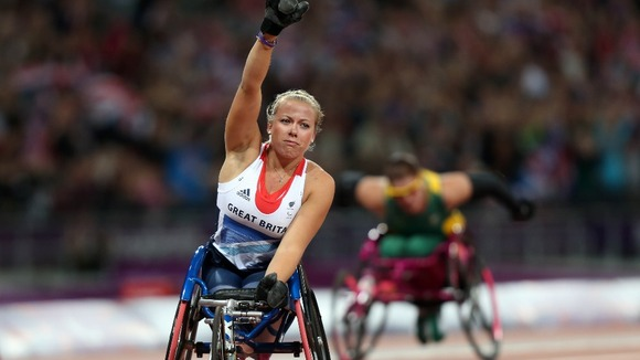 Great Britain's Hannah Cockroft celebrates winning Gold in the Women's 100m T34