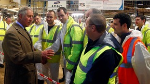 The Prince of Wales talks to workers during a visit to the McVitie's factory.