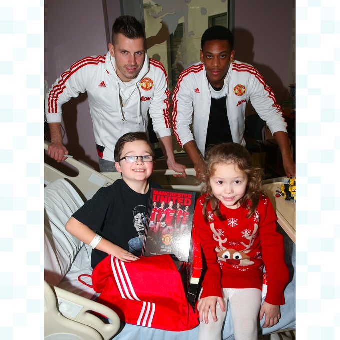 Morgan Schneiderlin and Anthony Martial meet Rhys and Grace at the Royal Manchester Children s Hospital