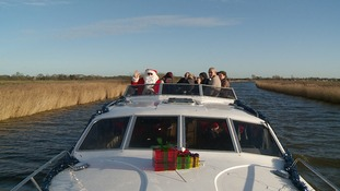 Santa takes to the Norfolk Broads to give bereaved children a festive Christmas treat