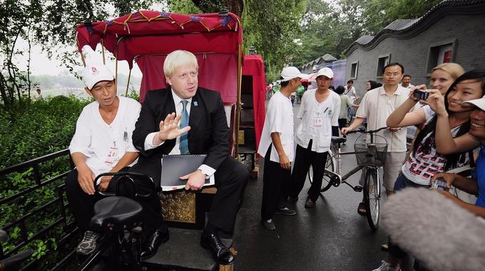 Boris Johnson in a rickshaw