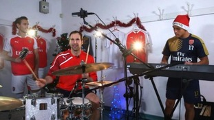 Arsenal players form Christmas band for charity