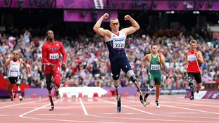 Nottingham's Richard Whitehead celebrates winning the Men's 200m - T42