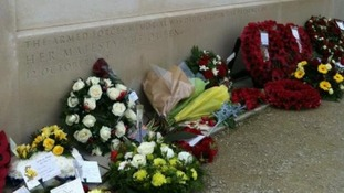 Flowers and wreaths laid in memory of loved ones