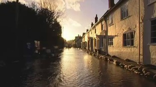 A flooded street in Hambledon