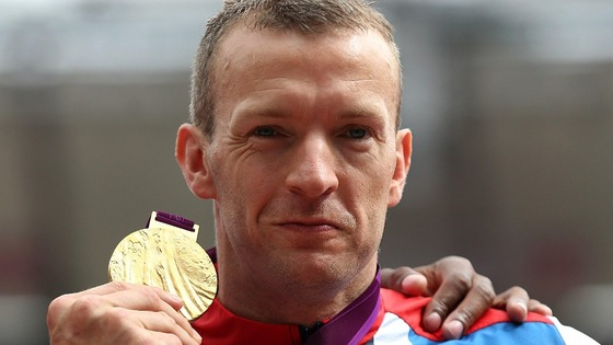 Great Britain's Richard Whitehead receives his Gold medal after winning the Men's 200m - T42