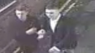 Police are looking to trace two men captured on CCTV after two people were assaulted outside a bar in Solihull.