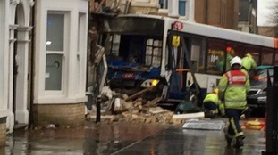A bus has crashed into a building in Peterborough.