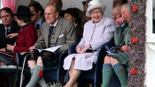 Queen Elizabeth II and the Duke of Edinburgh with the Prince of Wales at the Braemar Gathering.
