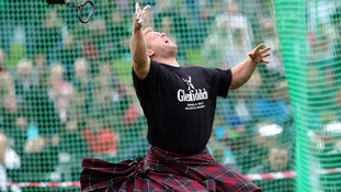 Scott Rider competes in the heavyweight competition at the Braemar Gathering.
