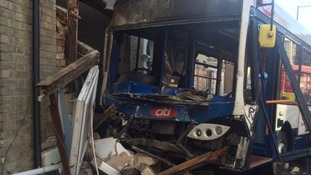 The bus caused severe damage to the office building.