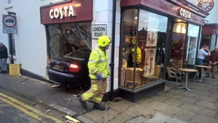 A woman died after a car hit the shop