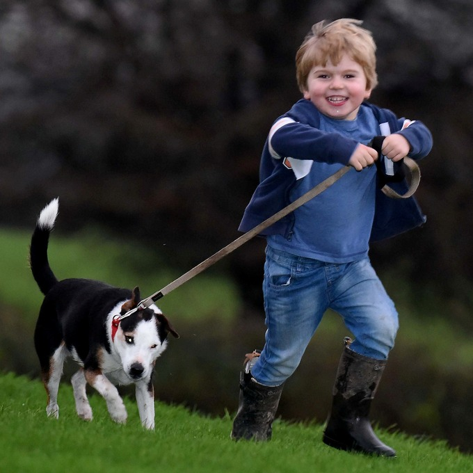 William couldn't hide his delight at being reunited with his furry friend.