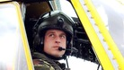Prince William sits at the controls of a Sea King helicopter