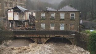 The former pub and restaurant has collapsed due to the River Irwell flooding