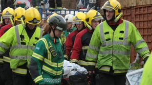 Emergency services carry a stretcher