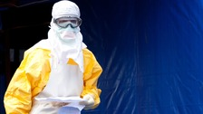 A medical doctor wears a protective suit at the ebola treatment centre in Guinea.
