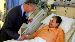 he Prince Of Wales talks to John Tulloch, one of the victims of the 7/7 bomb blasts in 2005
