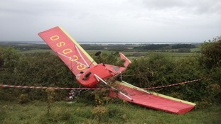 Two escape microlight crash