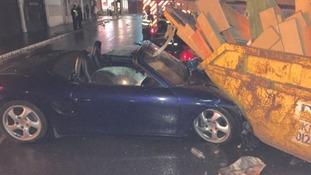 The Porsche hit a skip
