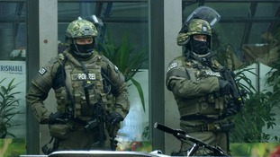 Armed police stand guard at a railway station in Munich.