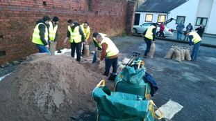 Syrian refugees help during the Rochdale floods