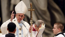Pope Francis blesses at the end of a mass on New Year's Day at St Peter's Basilica