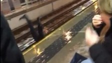 Shocking: Woman falls onto track
