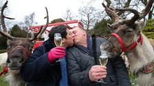 John and his wife Patricia - and Rudolf having a cheeky sip of champagne