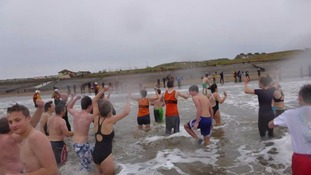 Runners brave St Bees chilly waters for a New Years dip