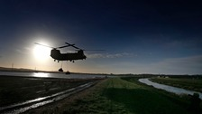 RAF Chinook helicopter airlifts giant sandbags, as the military help repair a collapsed bank on the River Douglas in Croston, Lancashire