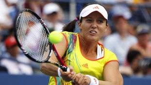 Laura Robson hits a return to Stosur during their singles match at the U.S. Open