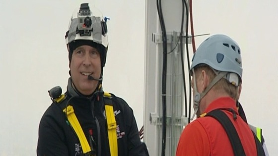 Prince Andrew smiles for the cameras before charity abseil.