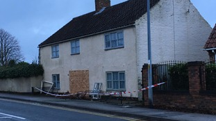 Damage to house in Lincoln after car crashes into it