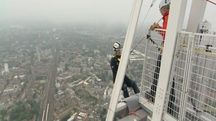 Prince Andrew begins the abseil, which takes about an hour.