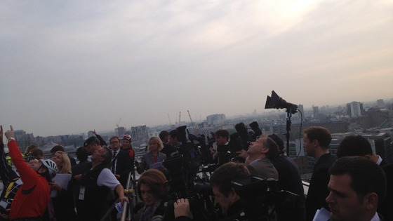The assembled media direct their camera lenses on The Shard.