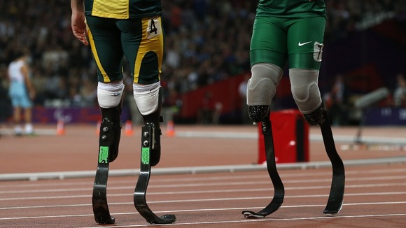 On the left, the blades of South Africa's Oscar Pistorius. The longer blades of Alan Fonteles Oliveira are on the right