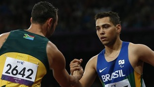 Oscar Pistorius and Alan Fonteles Oliveira after last night's race at the Olympic Stadium