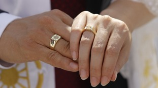 Newlyweds fold their hands at a mass wedding ceremony of the Unification Church at Sun Moon University in Asan, south of Seoul in 2010
