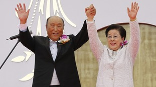 Reverend Moon and his wife Han Hak-ja during a mass wedding at Sun Moon University in Asan in 2010
