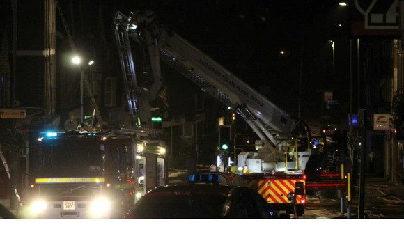 An aerial ladder platform is used to bring the fire under control