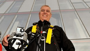 The 52-year-old completes the abseil.